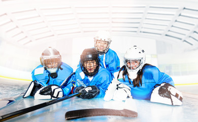 Hockey team laying on ice ring after the game