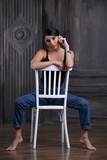 Woman sitting on a chair, studio portrait - 226574844