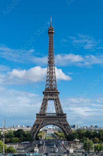 The Eiffel tower of Paris on a sunny day with blue sky