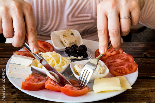 a woman eating turkish breakfast