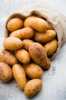 A bio russet potato wooden vintage background. - 226593497