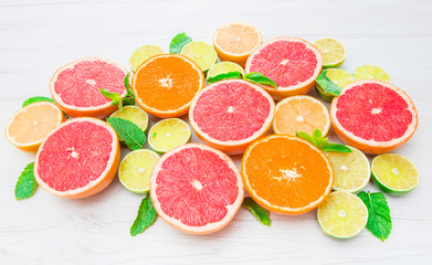 group of pink grapefruits, lime, orange and lemons