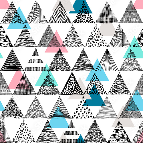Black and white hand-drawn triangles in a doodle style and colored triangles. Seamless vector pattern. - 226604013