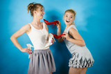 Women presenting high heels shoes - 226610643