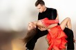 Leinwandbild Motiv Man and a woman dancing Salsa on
