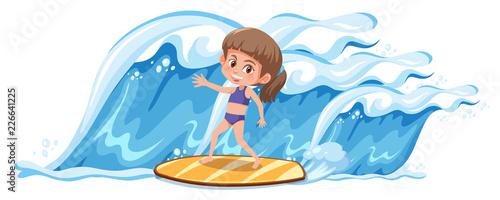 Fototapeta A girl surfing the big wave
