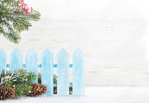 Foto Murales Christmas fir tree branch covered by snow