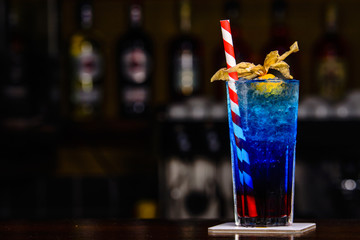 Blue cocktail on the bar tender