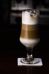 Ice coffe on the bar. Glass of ice coffe.