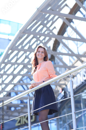 Leinwandbild Motiv confident business woman standing on the balcony of a modern office building