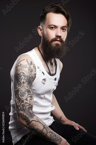 handsome man with beard. Brutal boy with tattoo