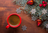 Red cup of coffee and fir branch with Christmas decorations on old wooden table. - 226695040
