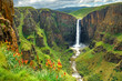 Maletsunyane Falls in Lesotho Africa. Most beautiful waterfall in the world. Green scenic landscape of amazing water fall dropping into a river inside canyons. Panoramic views over the great falls. - 226713404
