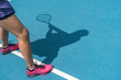 Shadow of woman tennis player