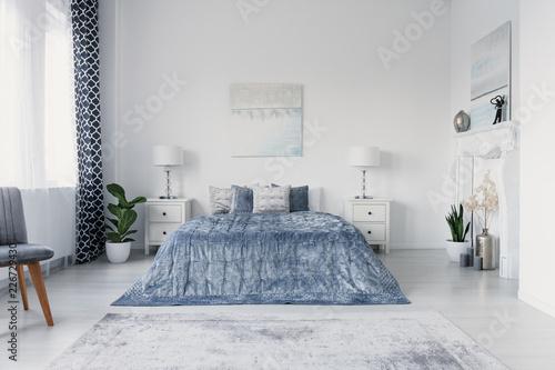 Leinwanddruck Bild Paining above big comfortable bed in luxury new york style bedroom, real photo