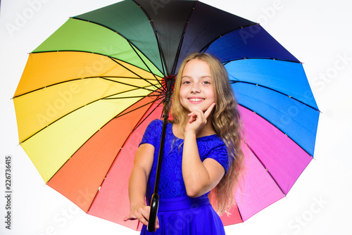 Leinwandbild Motiv Colorful accessory for cheerful mood. Stay positive fall season. Girl child ready meet fall weather with colorful umbrella. Ways to improve your mood in fall. Ways to brighten your fall mood