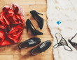Quadro scattered clothes and lovers shoes. Night of love. Selective focus