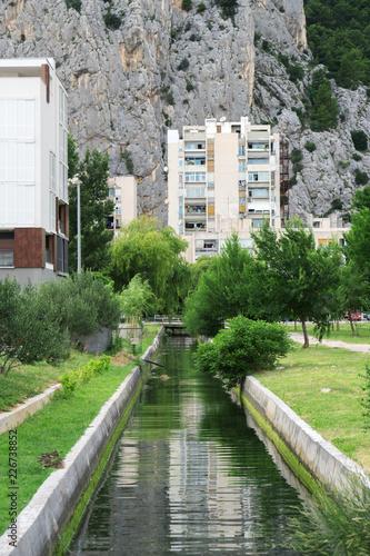 Water canal flowing thru the Omis city in Croatia.
