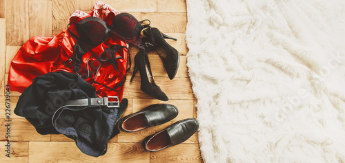 scattered clothes and lovers shoes. Night of love. Selective focus - 226739043