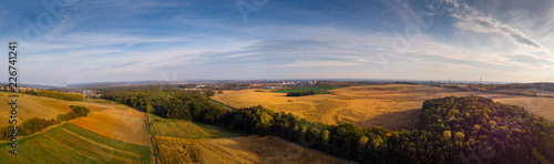 Autumnal fields and forests in the setting sun. - 226741241
