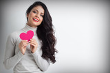 Woman holding pink paper heart - 226752493