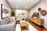 Living room in neutral colors with hardwood floor. - 226753496