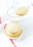 Shortbread with a glass of milk. White background. Close up. Copy space.   - 226756209