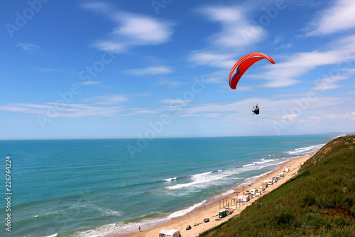 Foto Murales paragliding on the beach