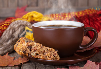Steaming Cup of Coffee and Raisin Cookie