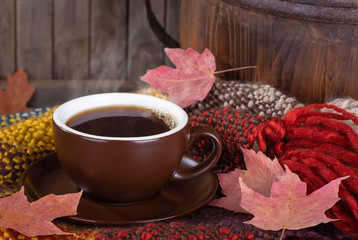 Steaming Cup of Coffee on a Colorful Blanket