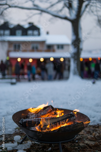 Foto Murales Fire bowl in the winter at a christmas market, Germany.