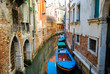 Line of boats in a Venice Neighborhood Canal