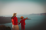 mother and little son looking at view in Santorini, Greece - 226788441