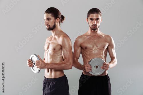 Foto Murales Portrait of a two muscular shirtless twin brothers