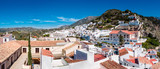 A Panoramic view of trhe hillside village of Frigiliana in  Anadalucia, Spain