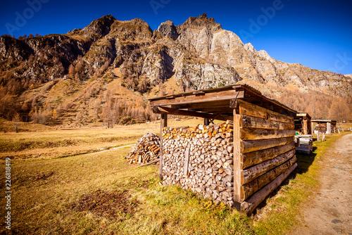 firewood storage in a beautiful mountain landscape - autumn season