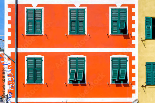 Foto Murales Colorful houses close up in Riomaggiore village Italy
