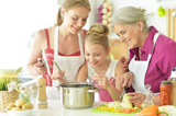 Portrait of mom and daughters cook to eat - 226829043
