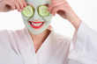 Leinwanddruck Bild - Woman with mask on face. Woman in spa. Beauty Treatments. Facial clay mask. Spa. Cosmetic mask. Spa treatments. Health. Clean skin. Mask with cucumber slices. Cucumber slices on eyes. Closeup.