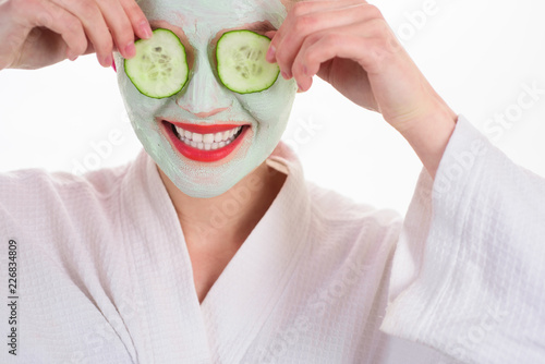 Leinwanddruck Bild Woman with mask on face. Woman in spa. Beauty Treatments. Facial clay mask. Spa. Cosmetic mask. Spa treatments. Health. Clean skin. Mask with cucumber slices. Cucumber slices on eyes. Closeup.