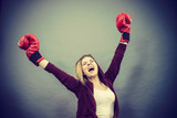 Woman winner wearing boxing gloves