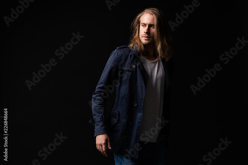 Leinwanddruck Bild handsome young and fit man posing in casual clothes, wearing jacket.