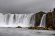 Icelandic waterfall in Icelandic natural landscape. Famous sights and attractions in Icelandic natural landscape on Southern Iceland