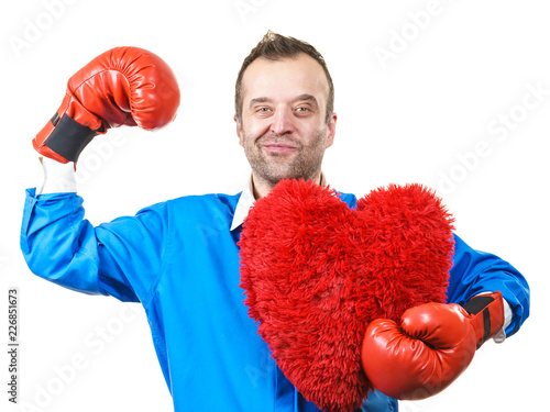 Man with boxing gloves holding heart