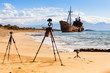 Camera on tripod and shipwreck