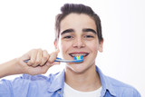 portrait of a young teenager with a toothbrush