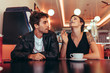 Quadro Couple sitting at a diner and having fun