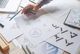 Graphic designer development process drawing sketch design creative Ideas draft Logo product trademark label brand artwork. Graphic designer studio Concept. - 226863892