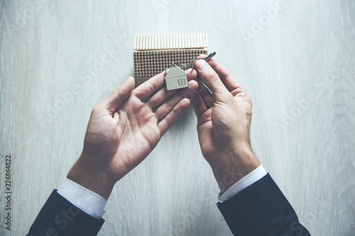 businessman with house model and key - 226864822