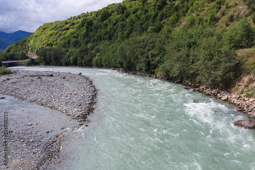 Foto Murales Mountain river with a rapid flow in the Caucasus Range ..